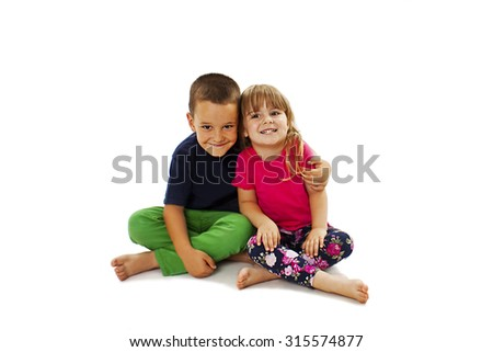 Loving sister and little brother hugging. Isolated on a white background.  - stock photo