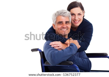loving supportive wife hugging handicapped husband isolated on white - stock photo