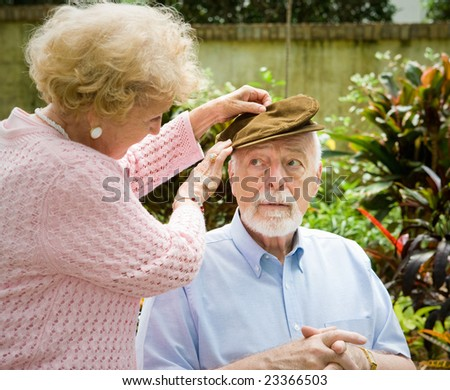 Loving wife cares for her elderly husband with alzheimers disease. - stock photo
