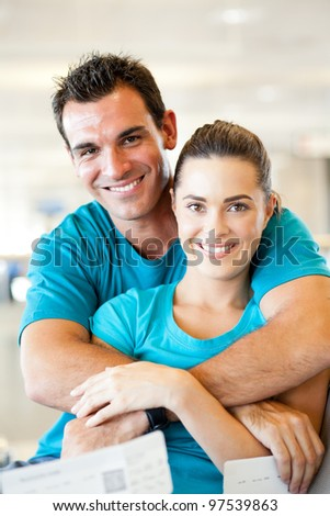 loving young couple at airport waiting for their flight - stock photo