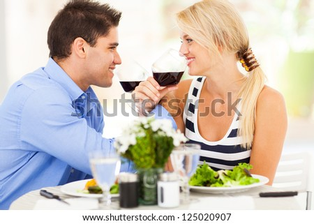 loving young couple drinking wine in restaurant - stock photo
