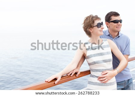 loving young couple enjoying their cruise vacation during honeymoon - stock photo