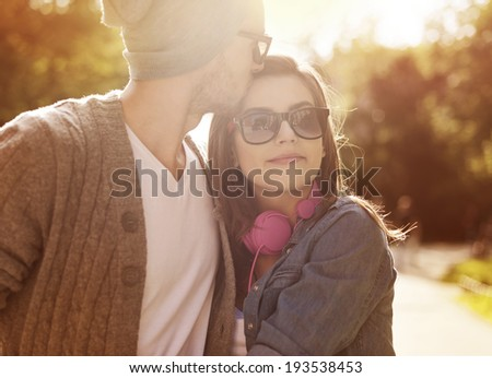 Loving young couple in sunlight  - stock photo