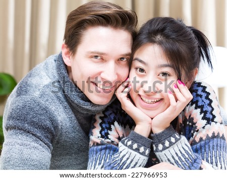 Loving young couple lying down on the bed. - stock photo