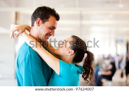 loving young couple say good bye at airport - stock photo