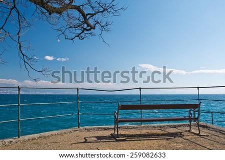 Lovran Croatia, photo of the benches on the shore of Lovran - stock photo