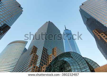 Low Angle Architectural View of Modern Glass Skyscrapers Featuring One World Trade Center Building Against Blue Sky, Manhattan, New York City, New York, USA - stock photo