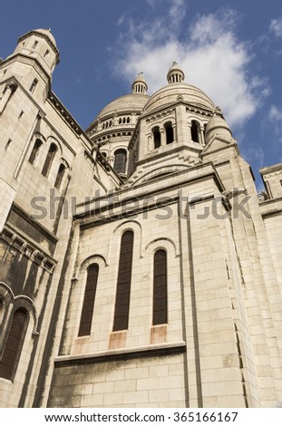 Low Angle Close Up View of Historic Sacre Coeur Basilica, Famous Landmark and Popular Tourist Destination on Montmartre Hill in Paris France - stock photo