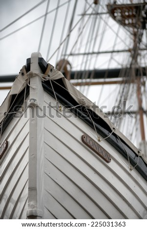 Low Angle Detail of Tall Ship Bow or Stern with Mast in Background - stock photo