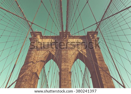 Low Angle Retro Color View of Arch Supports and Suspension Wires of Historic Brooklyn Bridge, Iconic Landmark Connecting Brooklyn and Manhattan, New York City, New York, USA - stock photo