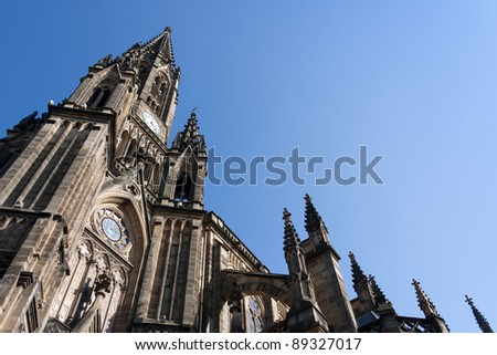 Low-angle shoot of an old cathedral and blue sky in the background - stock photo