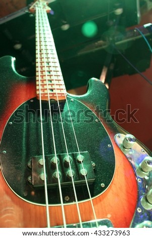 Low angle shot of a bass guitar prepared for gig. - stock photo