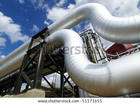 Low-angle shot of ladder and pipes refinery - stock photo