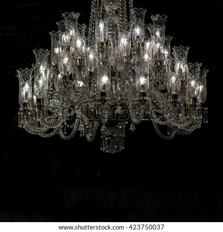 Low angle shot of old style ornate chandelier - stock photo