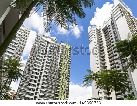 Low angle view of a few high raise apartment blocks - stock photo