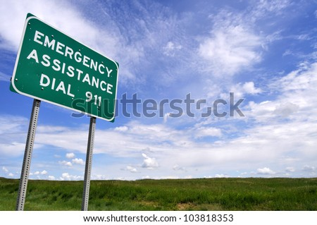 Low-angle view of a sign reminding motorists of the emergency number 911. - stock photo