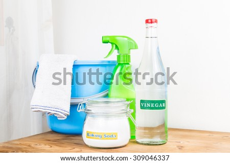 Low angle view of baking soda with vinegar, natural mix for effective house cleaning - stock photo