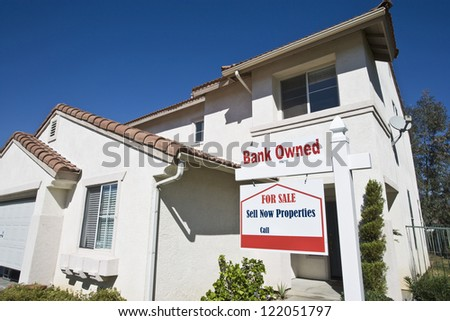 Low angle view of bank owned house for sale - stock photo