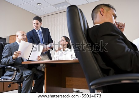 Low angle view of business meeting in boardroom - stock photo