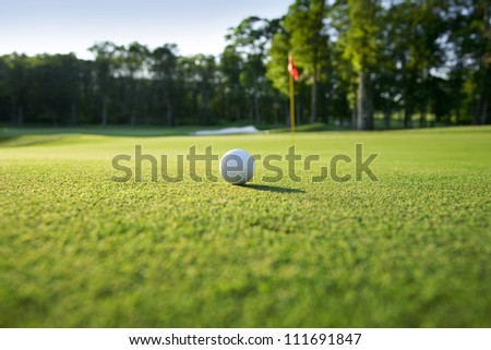 Low angle view of golf ball on green - stock photo