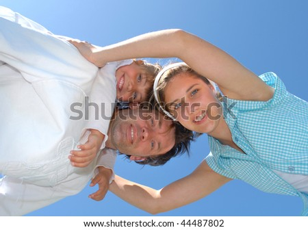 low angle view of happy family - stock photo