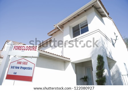 Low angle view of house building for resale - stock photo