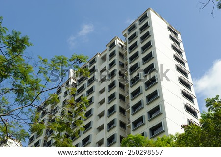 Low angle view of modern public housing in Singapore - stock photo