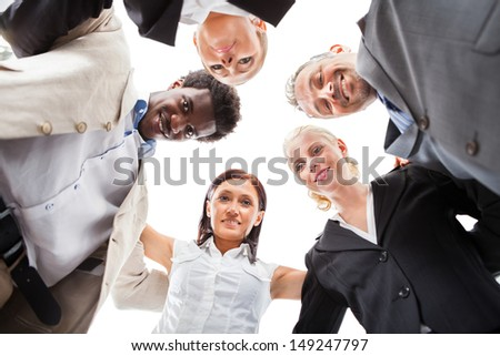 Low Angle View Of Multiracial Businesspeople Making Huddle - stock photo