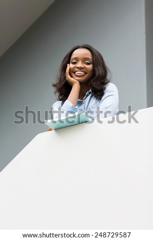 low angle view of pretty young african college girl - stock photo