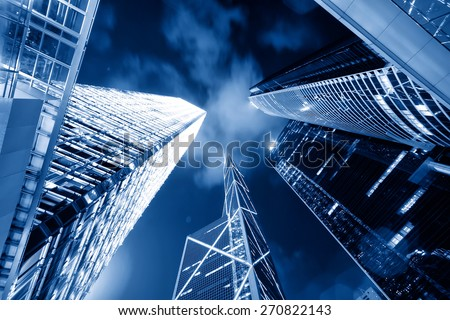 low angle view of skyscrapers and sky at night - stock photo