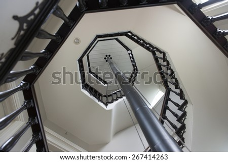Low angle view of spiral staircase, Manoir-Papineau National Historic Site, Montebello, Quebec, Canada - stock photo
