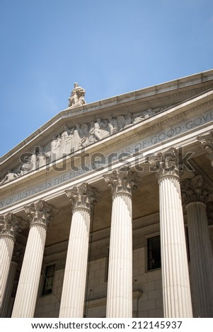 Low angle view of the facade of the New York County Courthouse in Manhattan, NYC. - stock photo