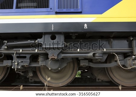 Low angle view of wheel of train - stock photo