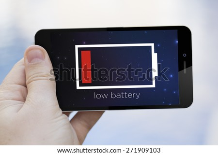 low battery concept: hand holding a 3d generated smartphone  - stock photo