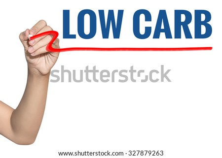 Low Carb word write on white background by woman hand holding highlighter pen - stock photo