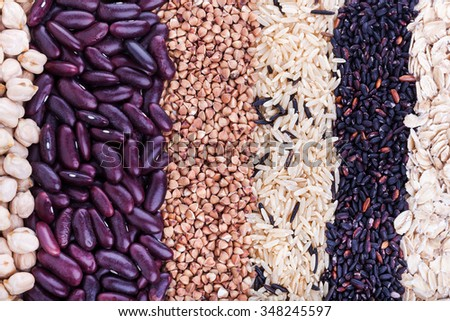 Low carbohydrates in assortment, oat, rice, beans, buckwheat and chickpeas, top view, selective focus. Healthy food concept - stock photo