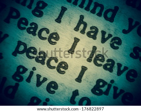 "Low Depth of Field macro shot of a Bible text from the Gospel of John chapter 14 verse 27 with the words of Jesus saying ""Peace I leave with you; my peace I give you."" - stock photo"