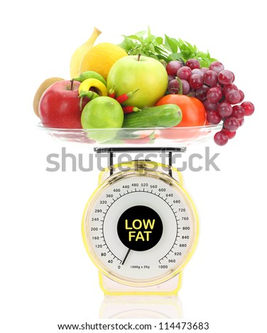 Low fat concept. Kitchen scale with fruits and vegetables - stock photo