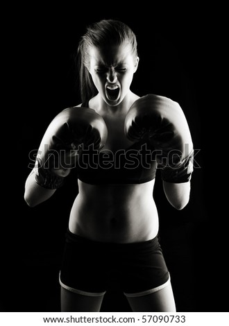 Low key artistic studio shot of a female boxer - stock photo