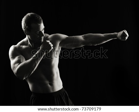Low key fighter - stock photo
