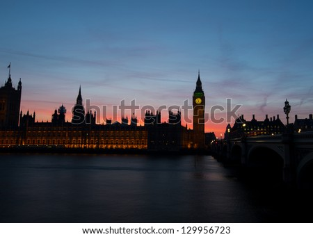 Low key Houses of Parliament on the river thames at dusk - stock photo