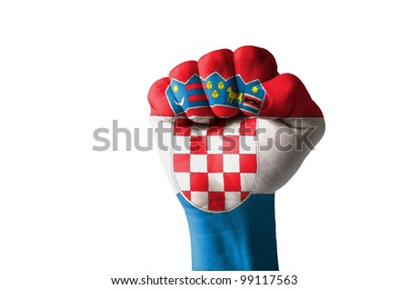 Low key picture of a fist painted in colors of croatia flag - stock photo