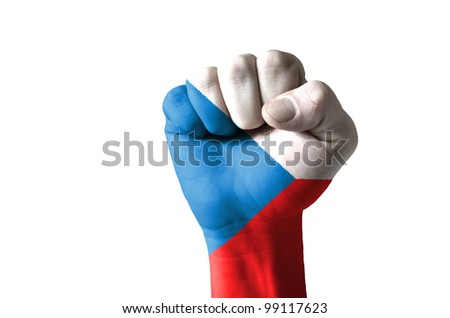 Low key picture of a fist painted in colors of czech flag - stock photo