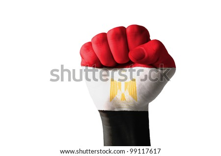 Low key picture of a fist painted in colors of egypt flag - stock photo