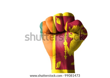Low key picture of a fist painted in colors of srilanka flag - stock photo