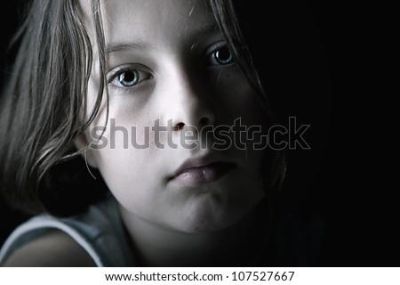 Low Key Shot of Sad Child - stock photo
