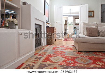 Low perspective still life of interior design home living room with a comfortable white sofa with cushions, and quality carpets, interior. Aspirational relaxing home family room, indoors lifestyle. - stock photo