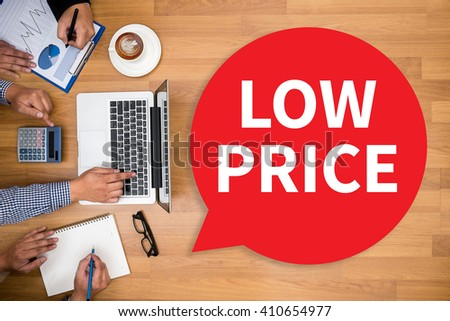 LOW PRICE Business team hands at work with financial reports and a laptop - stock photo