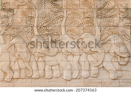 Low relief cement Thai style handcraft of elephant - stock photo