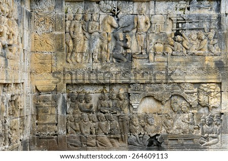 Low relieves on walls of the biggest Buddhist temple in the world showing scenes from Buddha, located on the Indonesian island Java - stock photo